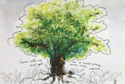 Painted image of a green tree with words surrounding it