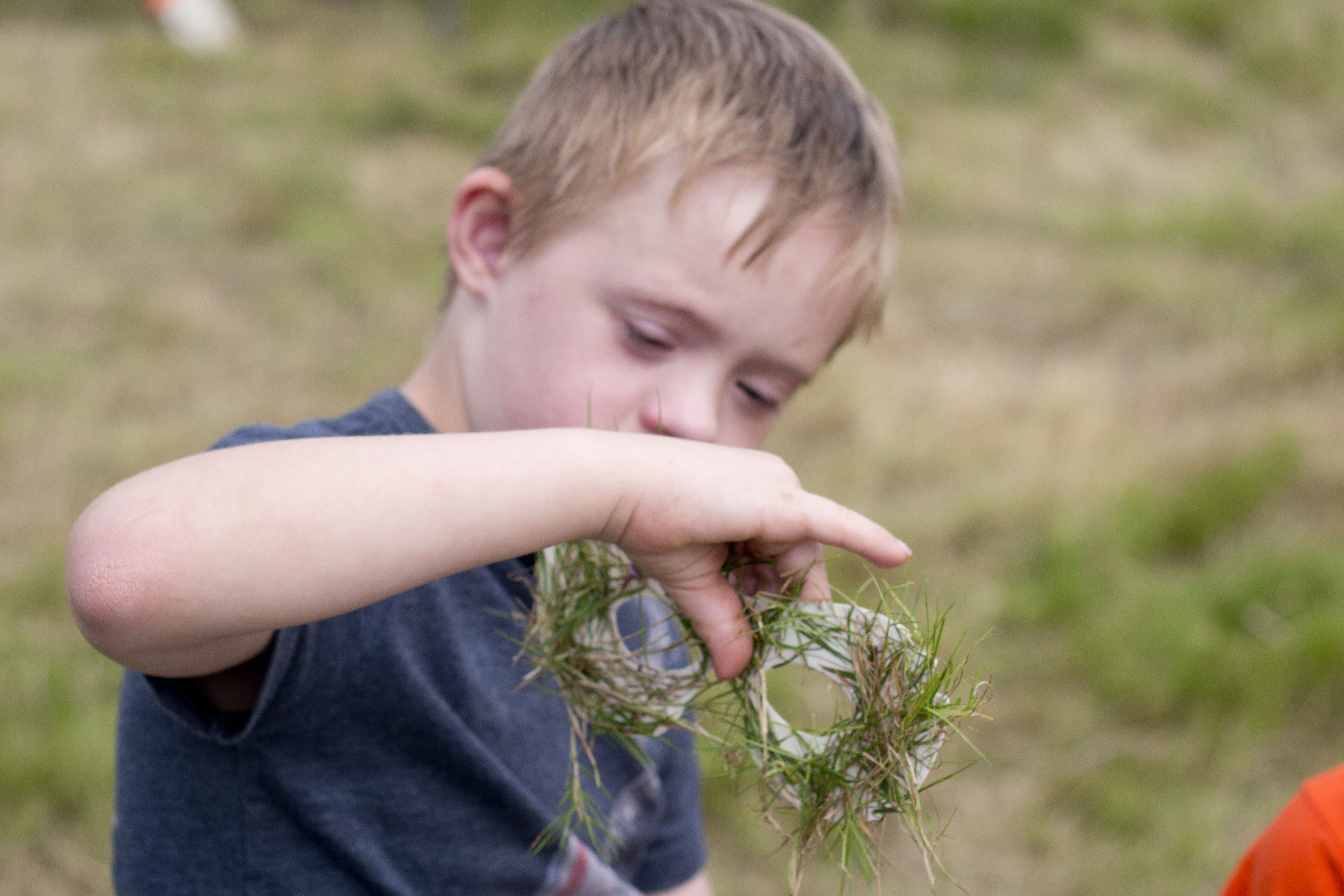 Young boy immersed in nature activity