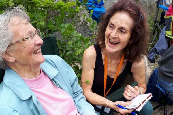 A volunteer and walking group member laughing together