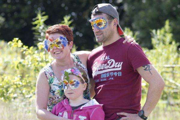 Family enjoying a Sensory Trust nature mask making activity