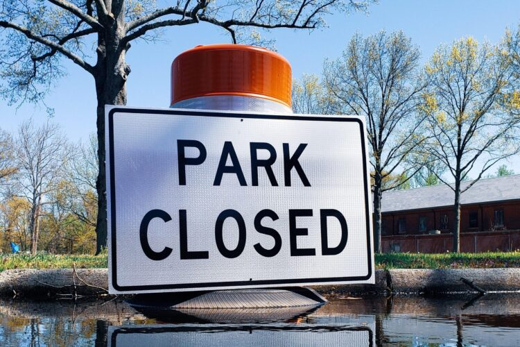 Sign saying park closed