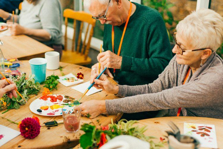 Older people enjoying creative nature activities indoors