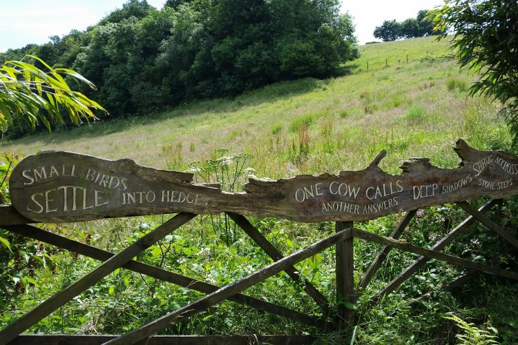 The gate of a care home inscribed with a poem