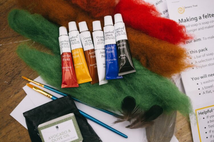 Paints, paintbrushes, felt and instructions for some activities