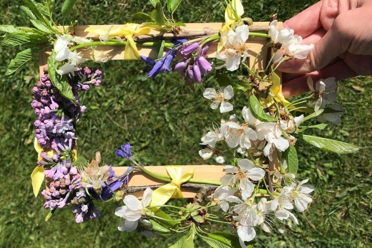 A frame made of leaves and flowers