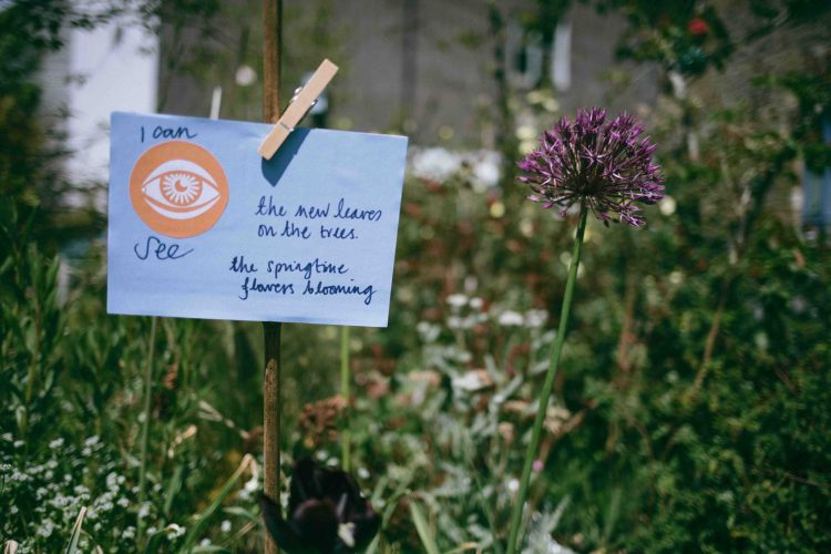 A sensory mapping card pinned on a fence