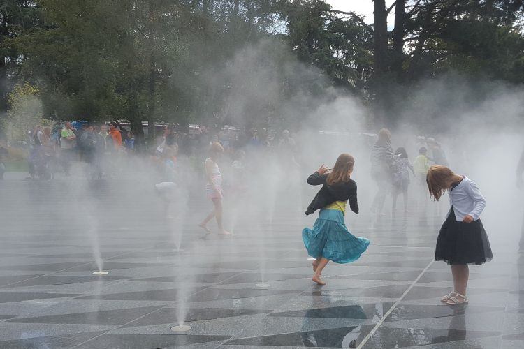 Children playing in water mists