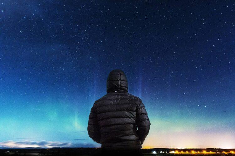 Silhouette of someone star gazing