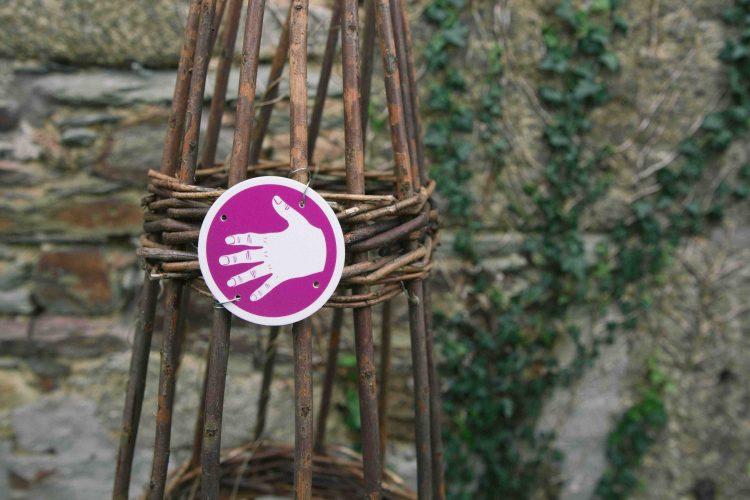 A hand symbol from Sensory Trust's sensory trail marker kit