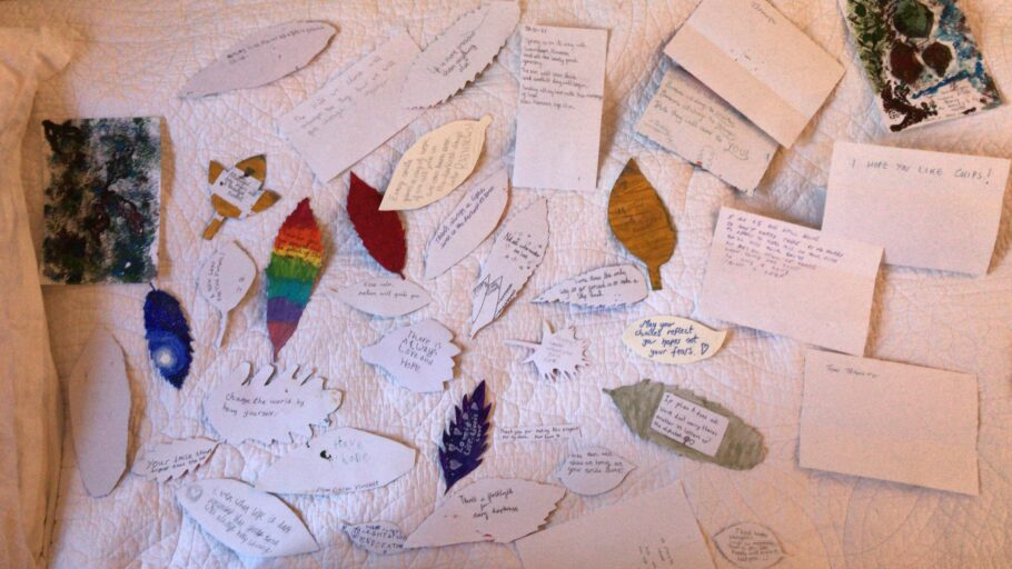 Hand drawn leaves with messages of hope written onto the back of them