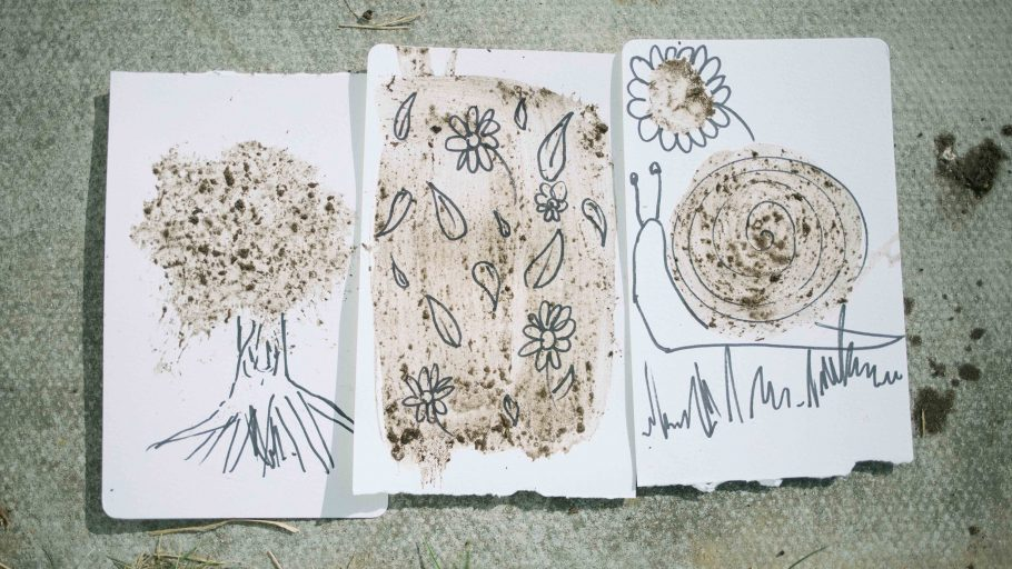 Examples of mud paintings showing flowers and trees