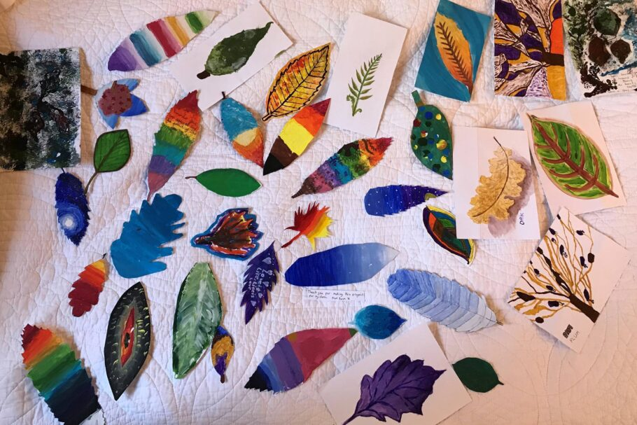 A collection of paper leaves hand painted in bright colours and patterns
