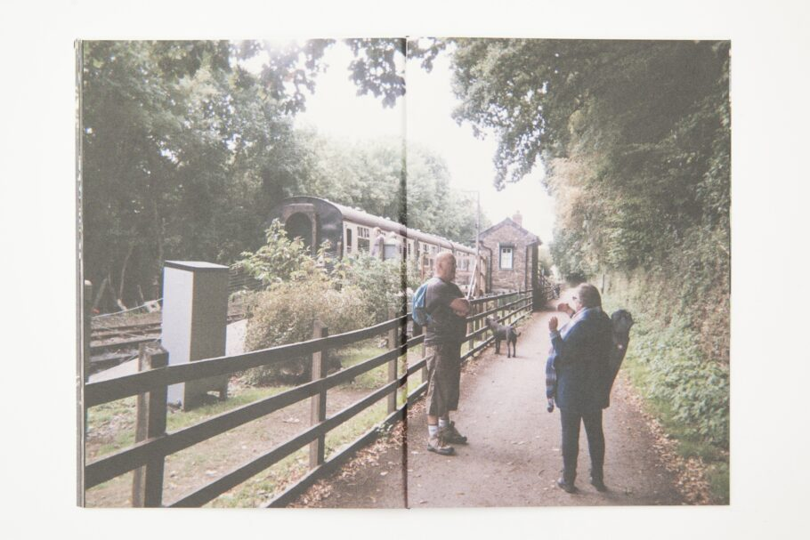 Picture taken using a disposable camera showing two adults walking along a wooded trail